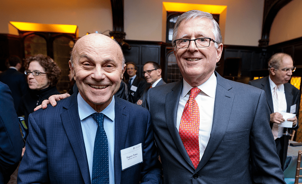 David Booth standing with Eugene Fama at the University of Chicago.